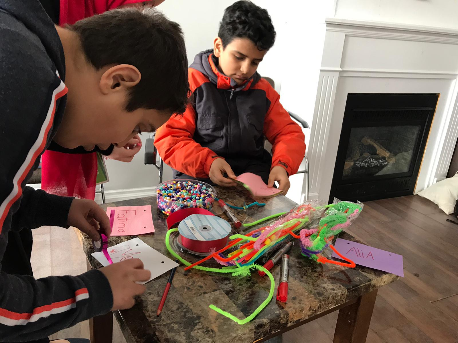 Kids crafting with pipe cleaners