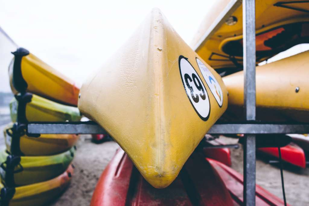 kayaks on standing racks